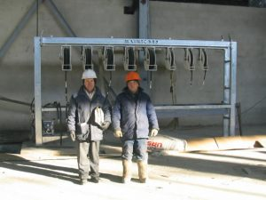 2 Men Standing In Front of Workshop Reel Frame